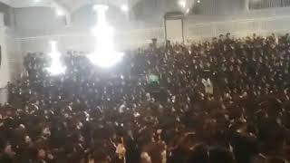 Thousands of European Satmar Chasidim singing  at special gathering with Satmar Rebbe R Aharon
