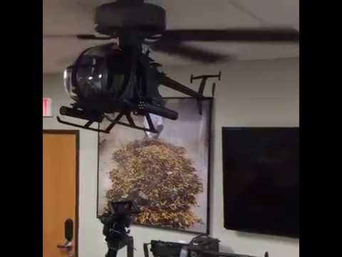 AH 6 Model Helicopter Hooked As A Ceiling Fan