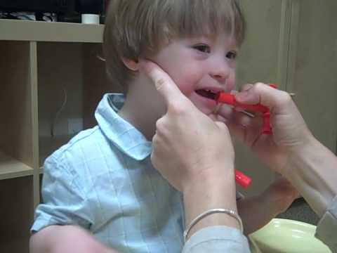 sam doing oral motor speech therapy with jennifer price