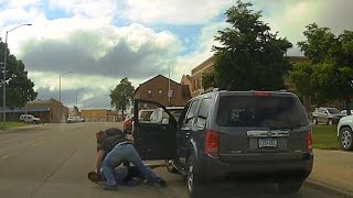 Video shows police officer kneeing and punching driver