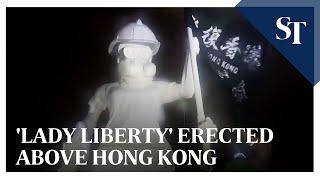 'Lady Liberty' erected above Hong Kong