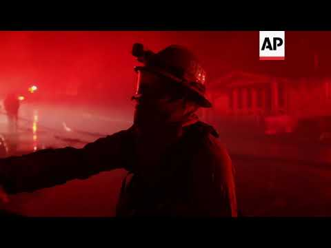 Southern California fire destroys dozens of homes before winds die down