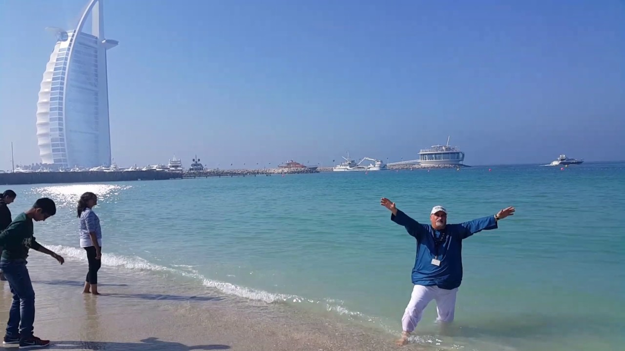 prof. dr. norman ali khalaf enjoying jumeirah beach near burj al