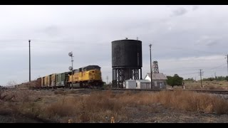 (HD) Fantastic Doppler Horn Effect as Fast Freight screams by Old Water Tank.