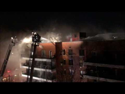 FDNY BATTLING 5TH ALARM FIRE IN A MULTIPLE DWELLING ON 94TH STREET IN ELMHURST, QUEENS, NEW YORK.