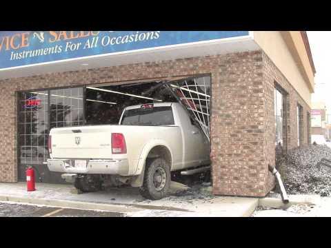 Truck crashes through store