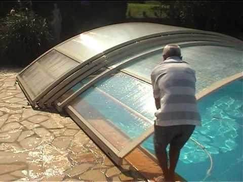 Abri piscine bas telescopique poolabri un abri de for Piscine en dur pas cher