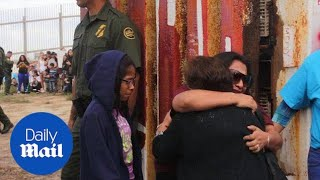 Families divided by U.S. Mexican border share a 3-minute hug - Daily Mail