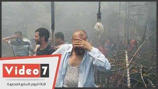 حريق سوق الملابس فى إمبابة.. بين صرخة الأهالى وبكاء أصحاب المحلات