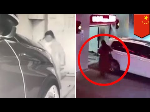 CCTV footage shows phone-addicted woman walking into parking garage and getting trapped - TomoNews