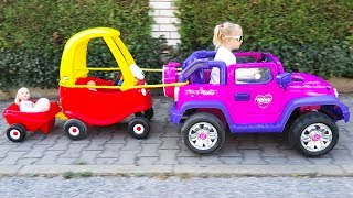 Little Gril Elis Plays Hide N Seek with Baby Dolls - Ride on Power Wheel Outdoor Activity