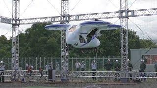 NECは5日、操縦士なしで空を移動する「空飛ぶクルマ」の試作機を報道陣に公開した。実験では、試作機が1分程度で約3メートルの高さまで浮...