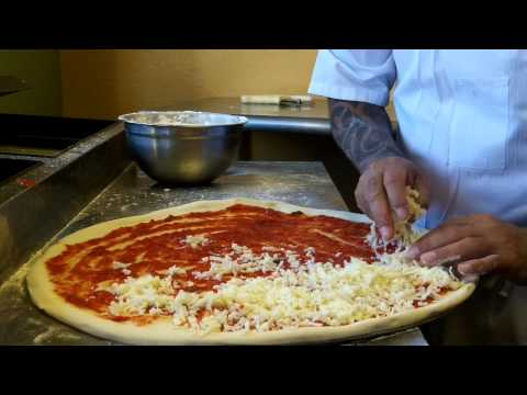 Efrain Makes a Pizza at Mama Romano's Italian Restaurant & Pizzeria