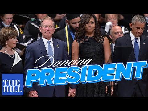 George W. Bush dances during the Dallas Memorial