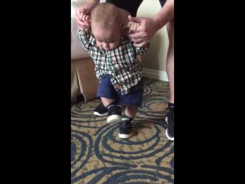 Infant's reaction to wearing shoes for the first time
