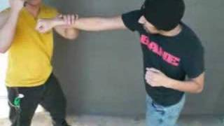 """DAMAG-INC """"Kali-fist"""", palm-stick techniques for streetfighting using the closed pocket knife."""