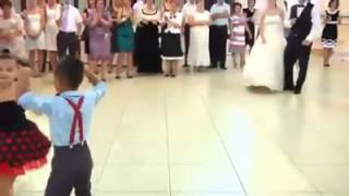 Two little kids are dancing at the mall