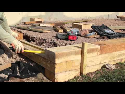Building a Wall with Oak Sleepers | TRC Garden
