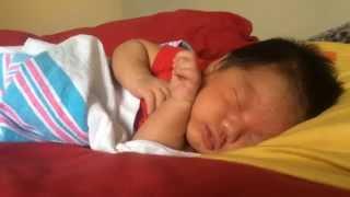 Sleepy newborn baby boy