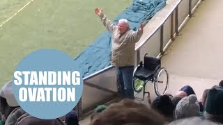 Video shows moment fan jumps out of his wheelchair to celebrate at football match
