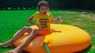 Jason play with colored water balloon surprises