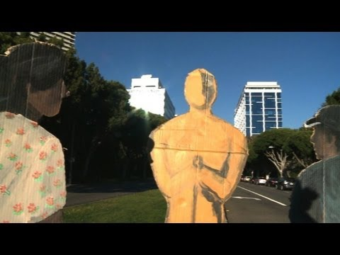 Artist paints Latino workers onto LA landscape