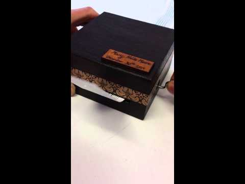 Gift of a kind music box plays personalised songs