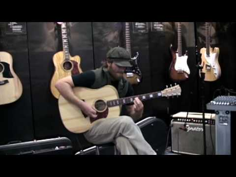 Trevor Green playing a Cole Clark FL2A at NAMM 2010