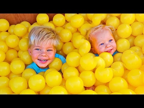 KIDS PLAY IN GOLD BALL PIT BALLS!