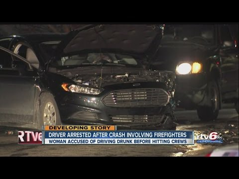 2 firefighters, EMT hurt when car drives into accident scene
