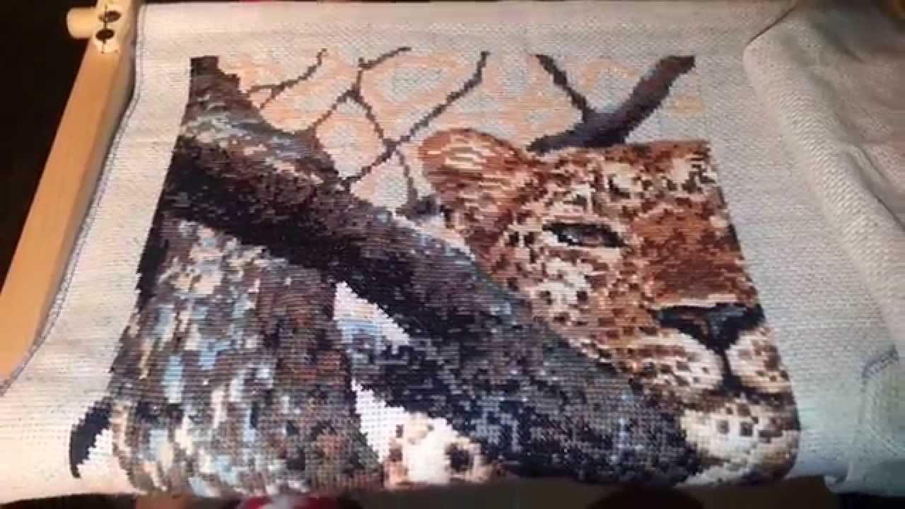 Вышивка леопард на ветке