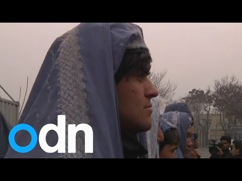 Afghan men wear burqas and march to support women's rights