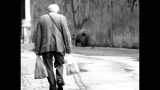 Mario Caprioli - UN SIGNORE DI IERI (poesia in italiano) con testo