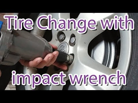 Changing tire with 7.5A electric impact wrench