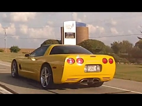 Yellow C5 Corvette turns towards Illinois Central College in East Peoria.