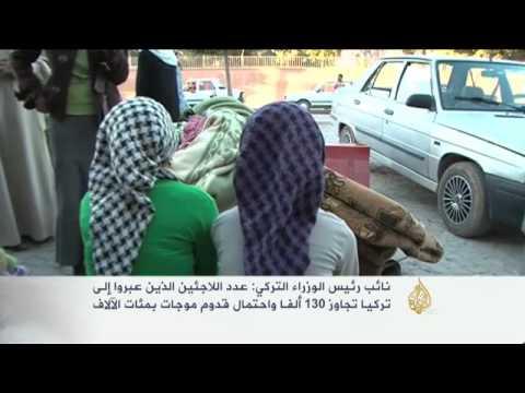 نزوح آلاف الأكراد السوريين إلى الأراضي التركية