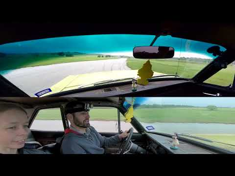 Driving a 1965 Ford Falcon around a racetrack in the rain