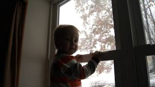 Phillip watching the snow come down