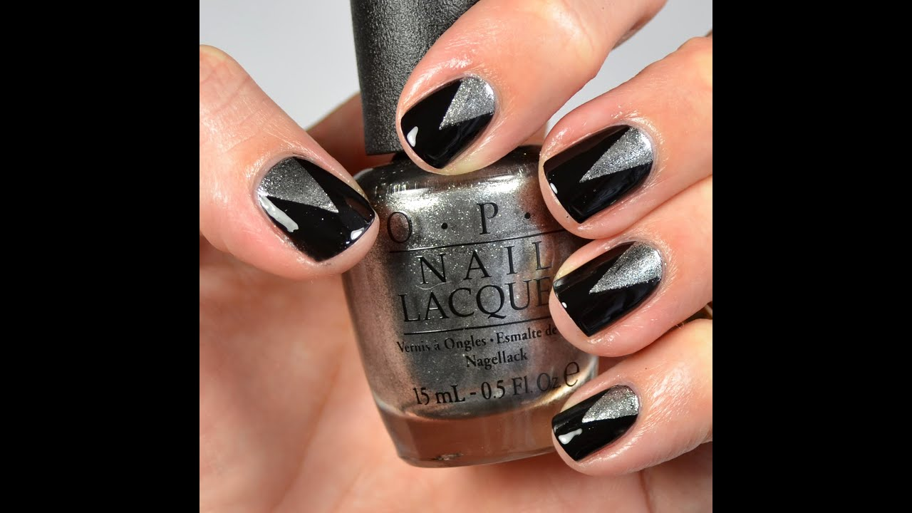 Black and Silver Triangle Nail Design