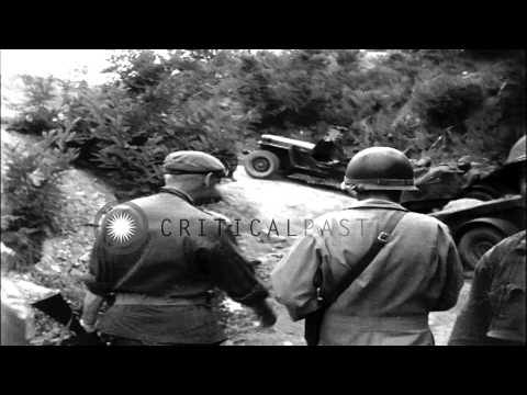 General Hobart R Gay shows Brigadier Coad situation maps at the 5th Cavalry Regim...HD Stock Footage
