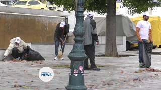 Ahmadi Muslims in Greece clean the streets on New Years Day