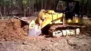 Cat 953C track loader. digging a borrow pit