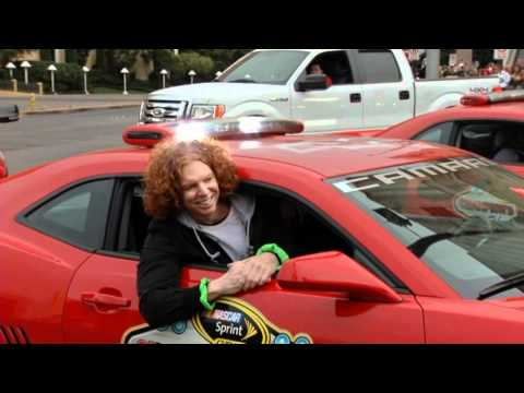 Carrot Top Scott Thompson rides in a red Camaro on the Las Vegas Strip Nascar
