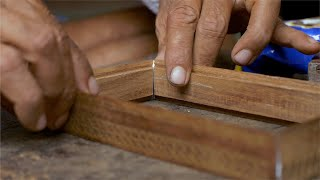 Tarkashi - A craftsman joining the ends of the wooden box with glue