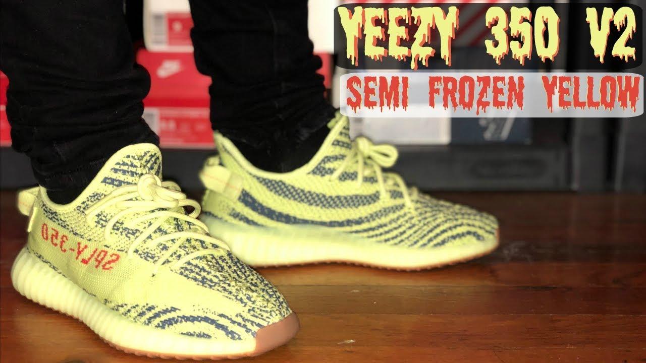 frozen yellow yeezy on feet