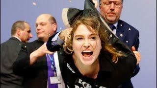 Jump around: Protester besieges ECB president Draghi, disrupts presser