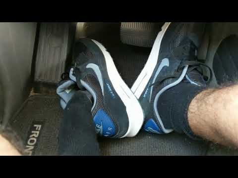 driving-in-nike-air-max-90-running-shoes-with-converse-socks