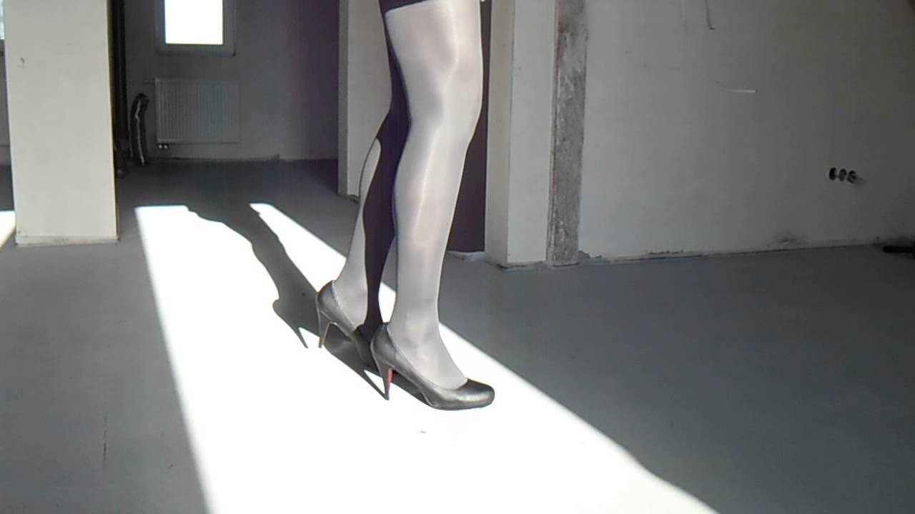 crossdresser in black high heels and graphite shiny tights 40 den