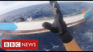 Dramatic migrant rescue as UN warns of rising deaths in Mediterranean and North Atlantic - BBC News