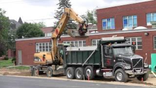 Cat M318C Unloading Dump Truck